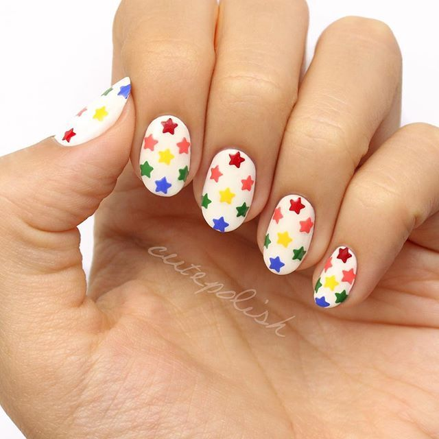 WEBSTA @ cutepolish - Have you seen the latest CutePolish video?  Learn how to create this ultra cute Rainbow Star design using a hole puncher! QOTD: What color/design are you currently wearing on your nails?