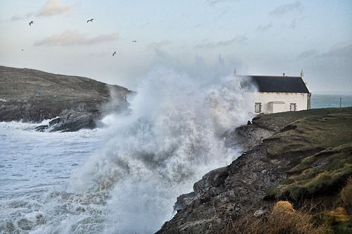 The old lifeboat station pounded by a wave