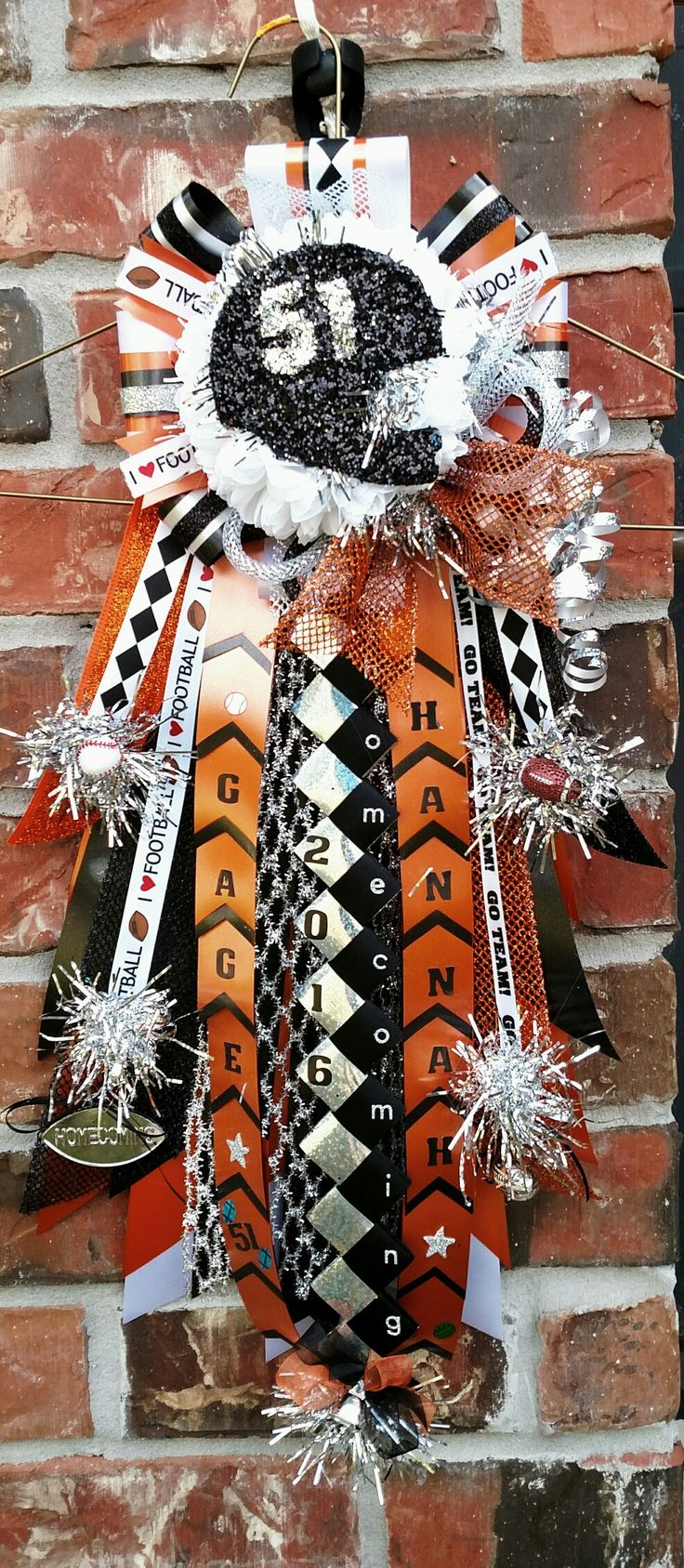 "Boys 18"" garter mum. Orange black white and silver homecoming mum. Designed by Crafty bug"