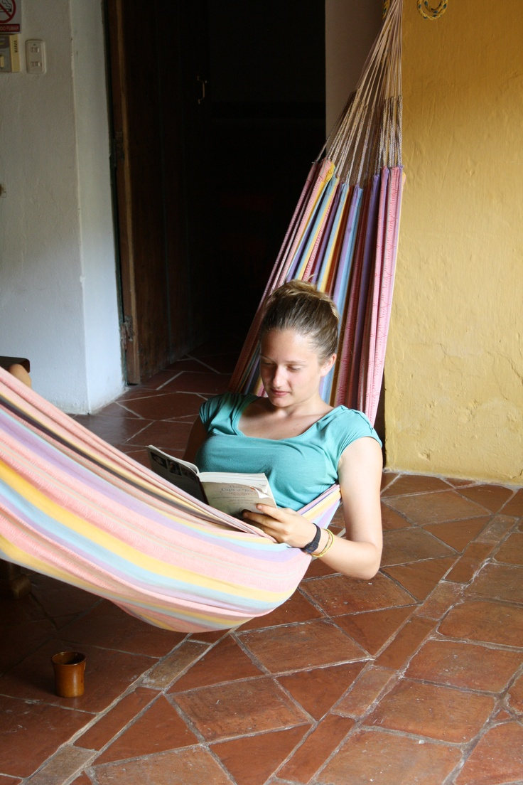a french tourist chilling in the hammock
