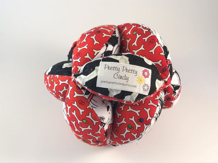 Amish Puzzleballs for babies and toddlers at Pretty Pretty Cindy on Etsy https://www.etsy.com/listing/583363315/jingle-fabric-tag-ball-baby-crib-toy