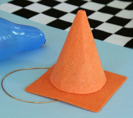 Fashioned from stiff orange felt, this bright-colored Cars cone cap will let the birthday boy cruise into the party zone in style. Find it at Disney Baby.