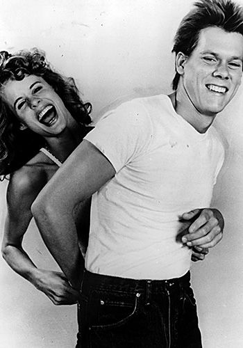 "Lori Singer and Kevin Bacon on the set of ""Footloose""."