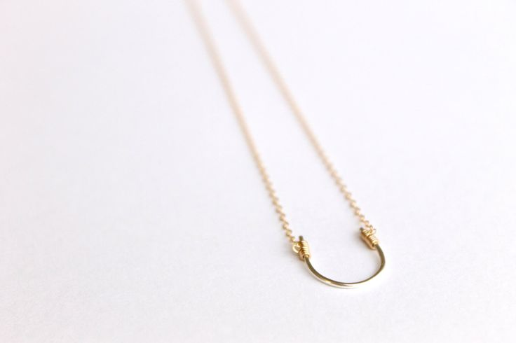 Lucky Horseshoe Necklace - 14k Gold and Sterling Silver - Wire Wrapped Necklace - Two Tone Necklace - Horse Pendant - Hammered Metal - Thin by MinimalistMagnolia on Etsy https://www.etsy.com/se-en/listing/192708908/lucky-horseshoe-necklace-14k-gold-and