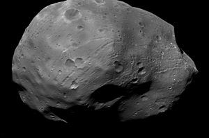 Orbiting a mere 3,700 miles (6,000 kilometers) above the surface of Mars, Phobos is closer to its planet than any other moon in the solar system. Visible on the small moon's unusually dark surface are many circular craters, long chains of craters, and strange streaks. MAVEN's apoapsis (farthest point in its orbit) takes it out to a similar distance from Mars on each, elliptical orbit. (Courtesy ESA/DLR/FU Berlin (G. Neukum))