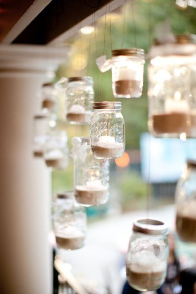 mason jars filled with sand and candles
