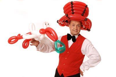 Ballonkünstler knotet Luftballontiere und Ballontiere für Ihre Veranstaltung - Eröffnung - Tag der offenen Tür - Jubiläum - Gewerbeschau - Leistungsschau