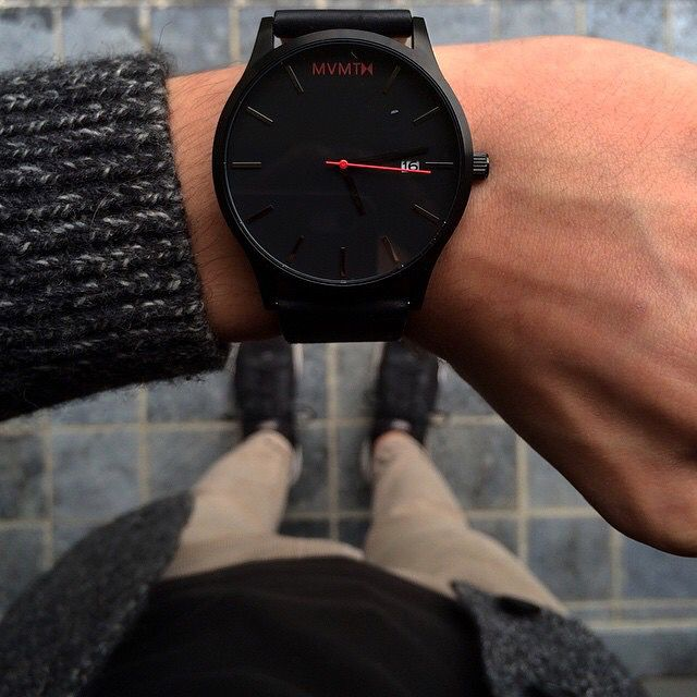 Go all black everything with this men's leather strap watch.