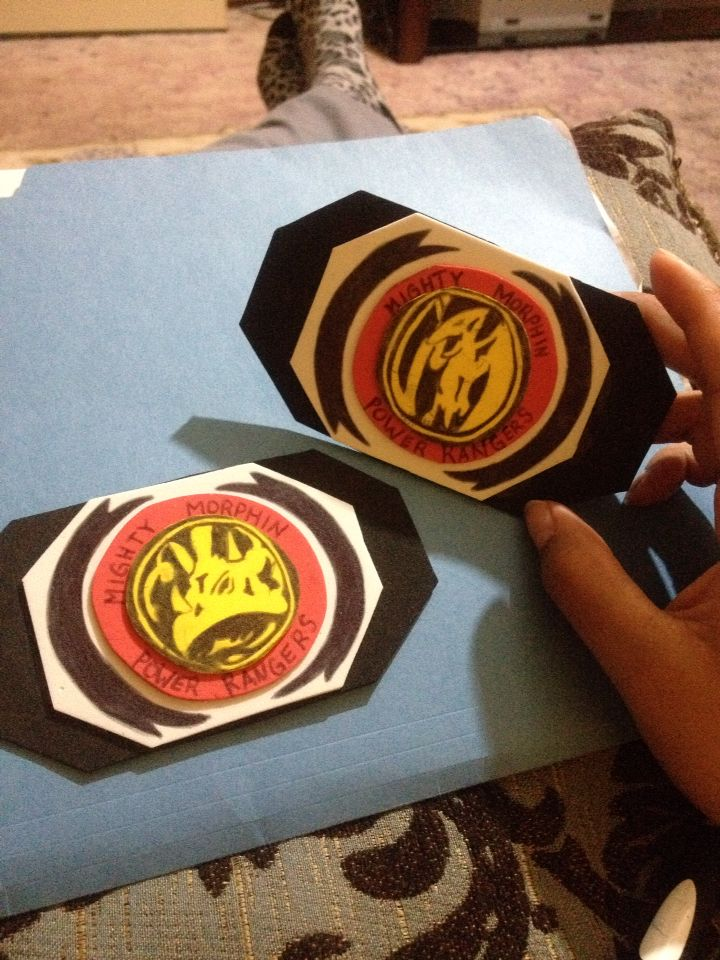 Homemade power ranger buckles to set off power ranger outfit! Used yellow, red, white, and black foam paper with details hand drawn ~$1-1.25 worth of materials used to make both buckles #pinkranger #DIY #halloween #blueranger