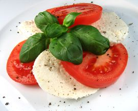 Simple yet, absolutely tasty! Basil, olive oil, pepper, tomato, and mozzarella!