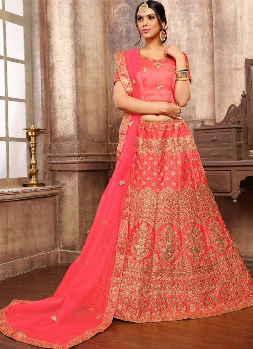 bda897fbc8d Pristine peach partywear lehenga choli online for women which is crafted  from satin fabric with exclusive
