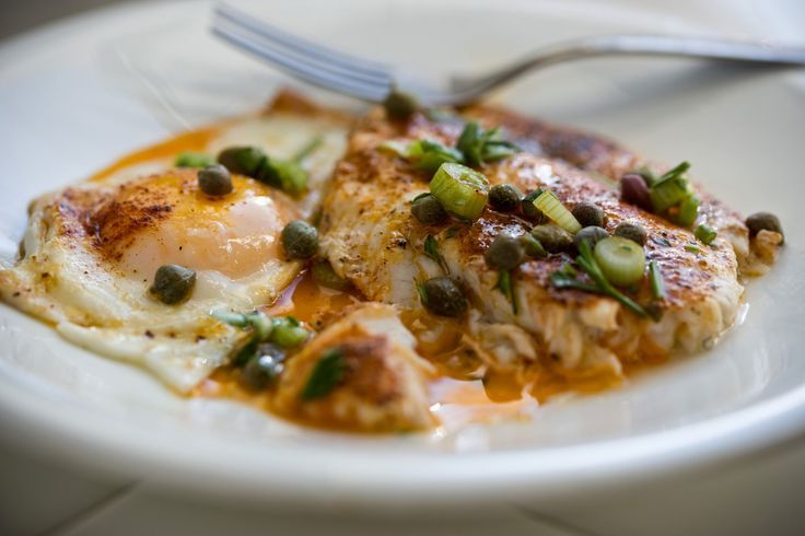 Fish is a breakfast staple all over the world, from the grilled fish and rice of Japan, to kippers and eggs in England, to bagels-and-lox brunches But here, fresh flounder for breakfast is exotic and unexpected This recipe puts the fish and the eggs in one pan and adds a pungent green garnish.
