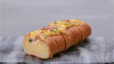 Make this cheesy bacon and egg-filled bread boat for a brunch party