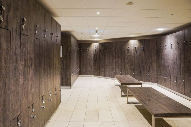 """A mix of L-Shape lockers with full hanging compartments and bag holders, and traditional 2 column lockers were used in the changing rooms. For an enhanced quality feel Sports Direct opted for """"anti-slam"""" soft closures on the doors. A number of smaller security lockers conveniently located opposite reception were also installed for wallets and phones. The design team chose an off standard """"Volcano Grey"""" finish with a deep textured feel on the locker doors and benches."""