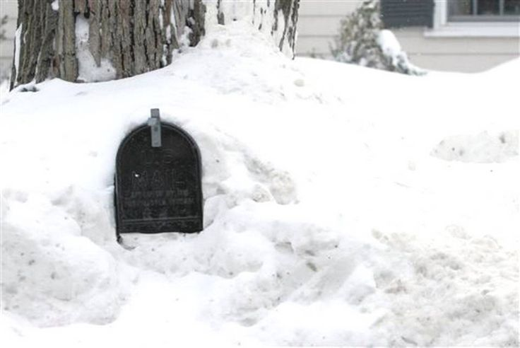 A mailbox sits in a pile of snow Wednesday, Feb. 11, 2015 in Weston, Mass. The National Weather forecasts a weak weather system that may bring 2 to 4 inches of new snow Thursday into Friday morning to the region, which already has seen record snowfalls this winter.  BILL SIKES/AP