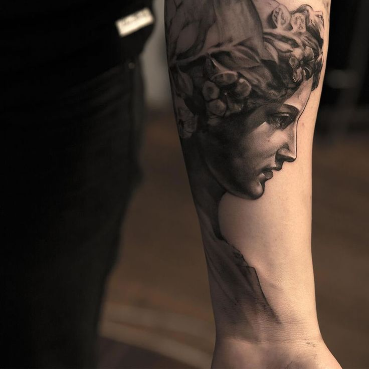 angel tattoo on inside arm by niki norberg