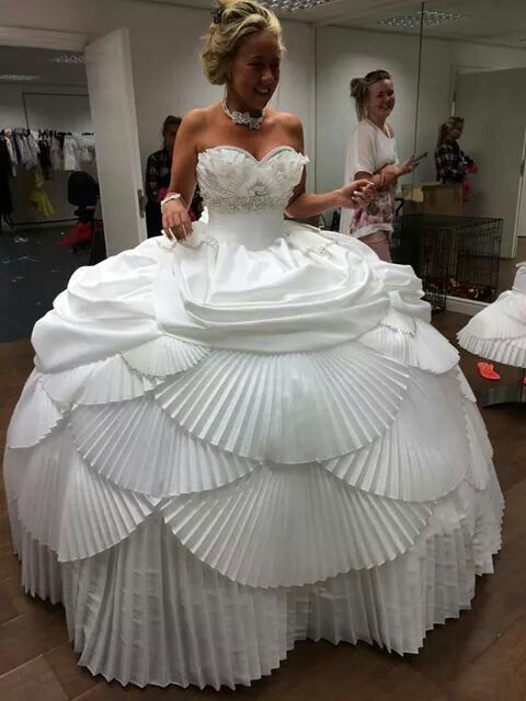 Worst wedding dresses: Pleated wedding dress. ow that is a lot of pleats. Handy if it rains though, all your guests can hide underneath it. #worst #wedding #dress