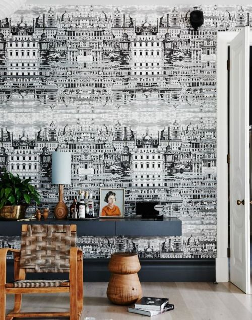 Source: Room Edit for Living EtcI'm loving this eclectic space! Everything from theFornasetti wallpaper, charcoal coloured consoleto the wood accents. Simple but so cohesive & interesting!