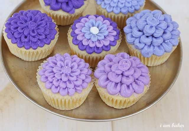 Petal cupcakes.  place icing on top of cake to cover.  Using tip 101 pipe outside petals.  Work to inside.  On the cupcakes with raised middle, put a bigger dollop in middle and pip over icing.