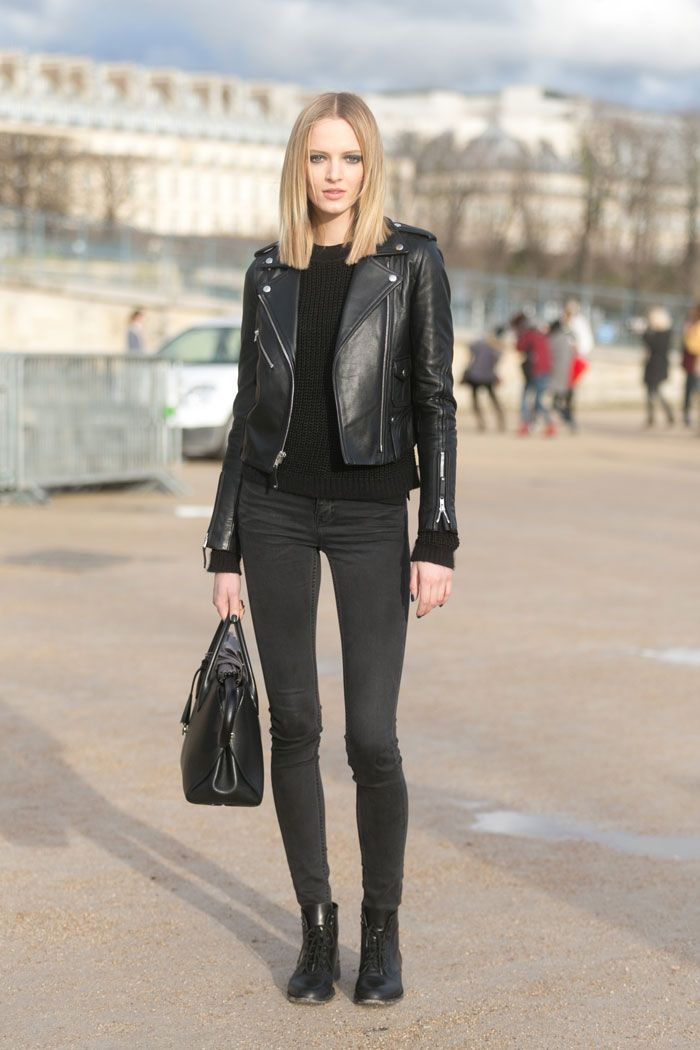 Shop this look on Lookastic:  http://lookastic.com/women/looks/cable-sweater-biker-jacket-skinny-jeans-tote-bag-boots/5544  — Black Cable Sweater  — Black Leather Biker Jacket  — Charcoal Skinny Jeans  — Black Leather Tote Bag  — Black Leather Boots