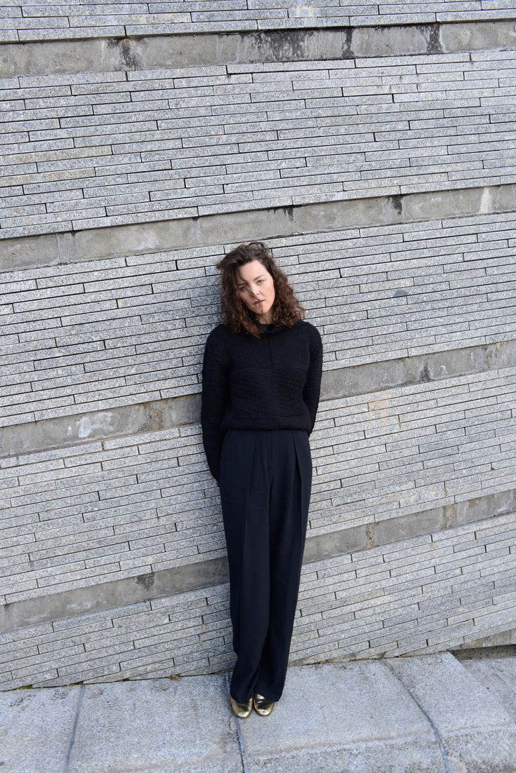 Kiki Albrecht in a black knitwear jumper by Lala Berlin