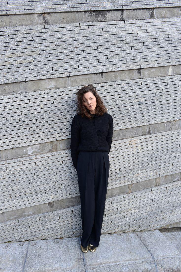 Kiki Albrecht in a black knitwear jumper by Lala Berlin