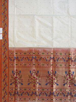 Jacquard Paithani Saree: beautiful cream saree with elaborate border