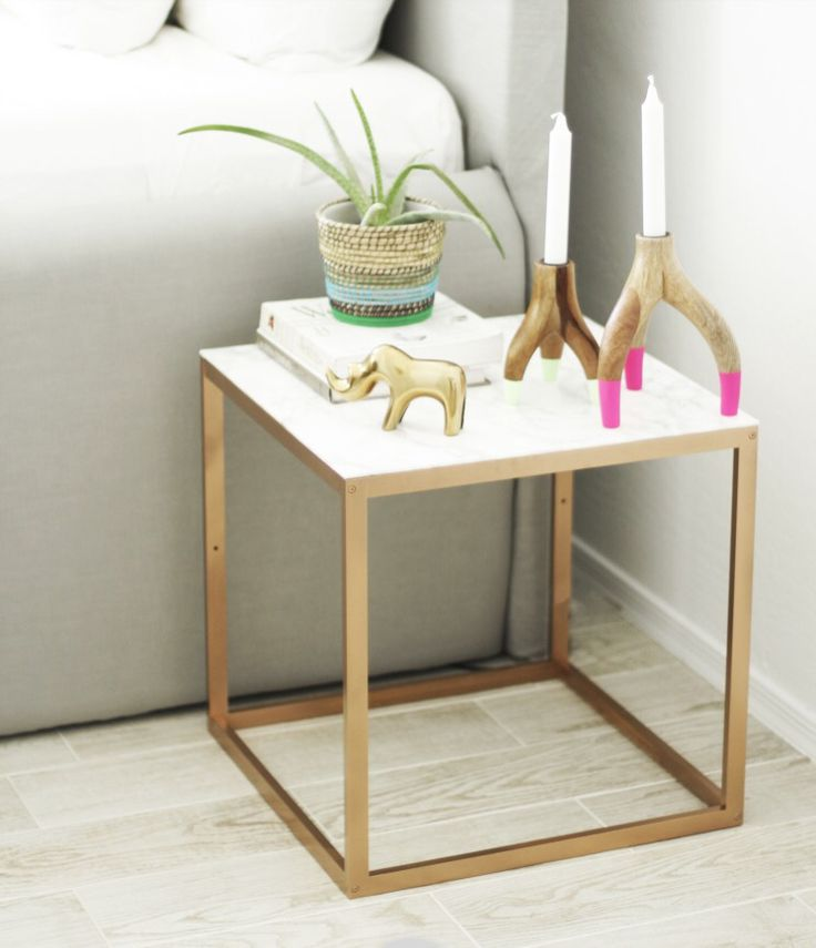 IKEA side table painted gold with marble paper top