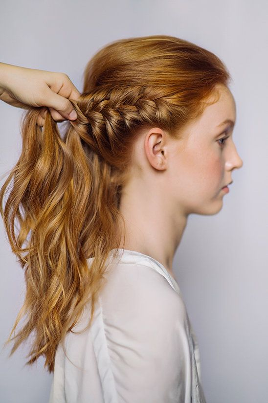 Step Four: Start a thick braid using the hair above the ear. Braid back towards the pins from the half-up. Pin braid into place.