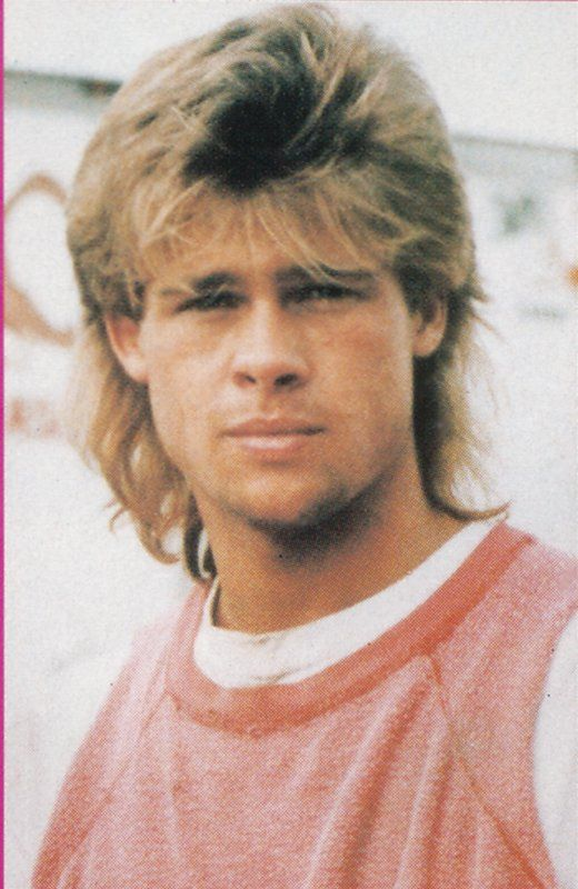 Man with a 80s mullet hairstyle with shaved lines on side of head brad pitt through childhood high school and college celebrities then and now 1980s hairstylesguy hairmulletscelebrities urmus Images