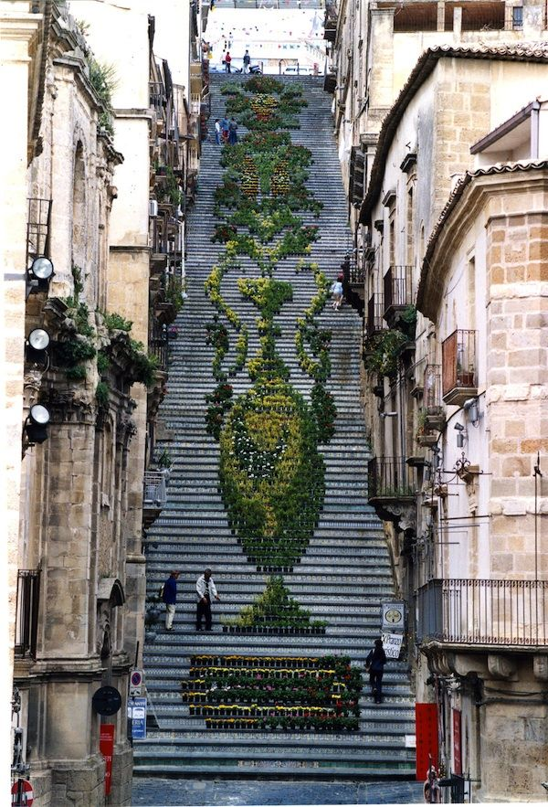 In a small town in Sicily called Caltagirone, built in 1608, the Staircase of Santa Maria del Monte has 142-steps which are each decorated with a different ceramic, using styles and figures derived from the millennial tradition of pottery making.  Each year, during the La Scala Flower Festival, about two thousands potted plants and flowers of different shades and colors are arranged on the historic staircase to create one grand design.
