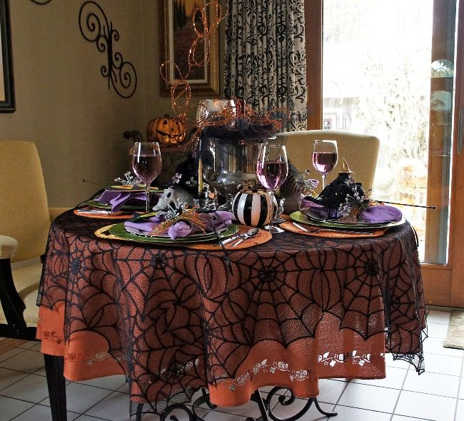 Ohhhh, take a look at this! I'm not a fan of celebrating Halloween but this... THIS is so incredible! The spiderweb lace overlay is really fun!