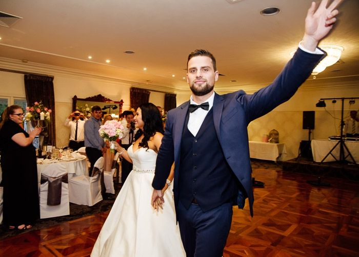 groom reaching out to say hi to crowd at Ballara Receptions #wedding #weddingphotography #melbourne