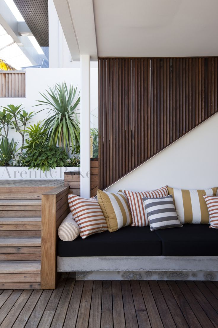Modern white & concrete with wood cladding. The strips in varying thickness & directions mimic the wood & keep your eye moving. outdoor benchseat | photography by Jason Busch