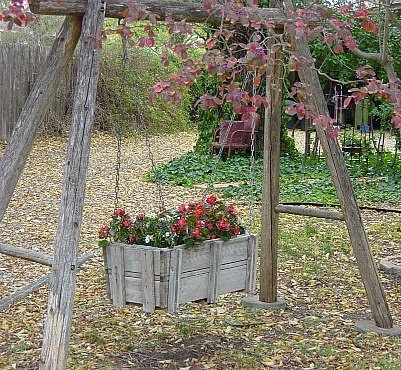 Recycle an old wooden swing into a garden treasure.