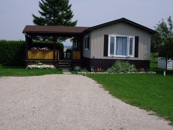 Traditional Mobile Homes With Grey Color Exterior Panel Also White Frames Of Windows Also Natural Wooden