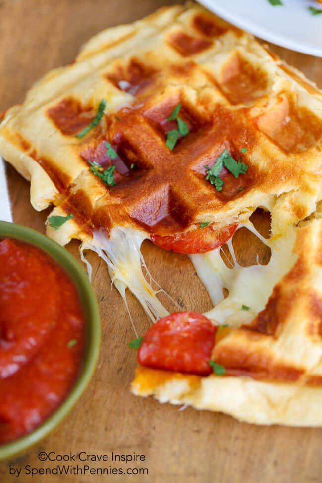 "Waffle Iron Pizza: You're only three ingredients away from pizza. And not just any pizza—each slice is ""easy, cheesy and crazy good,"" according to the blogger."