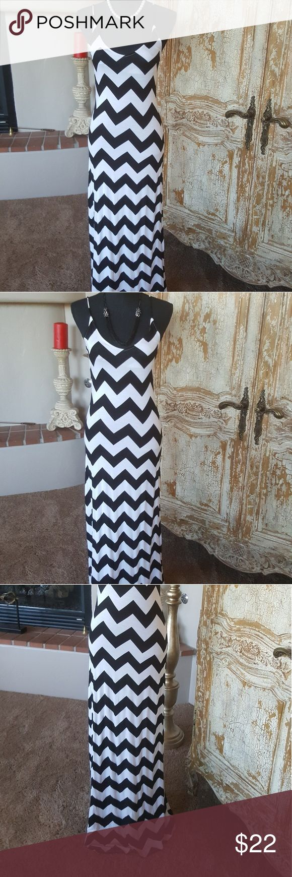 Black and white Chevron Maxi dress New w/out tags Alloy New without tags black and white chevron maxi. Made in USA. 97% Rayon 3% Spandex.  Measures approx 14 inches across for Bust and 59 inches in length. ALLOY Dresses Maxi