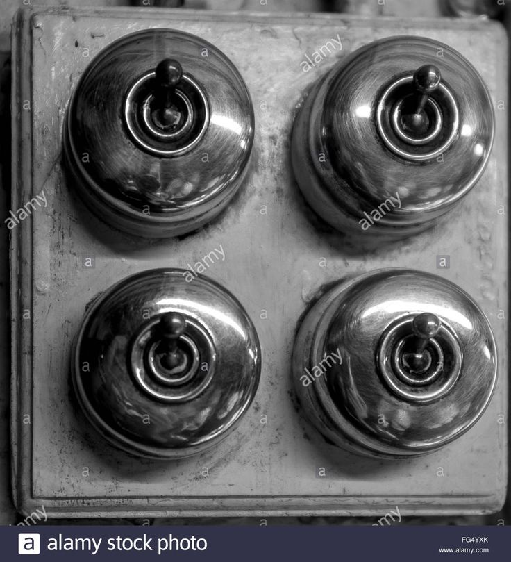 Download this stock image: Close-Up Of Old Light Switches - FG4YXK from Alamy's library of millions of high resolution stock photos, illustrations and vectors.
