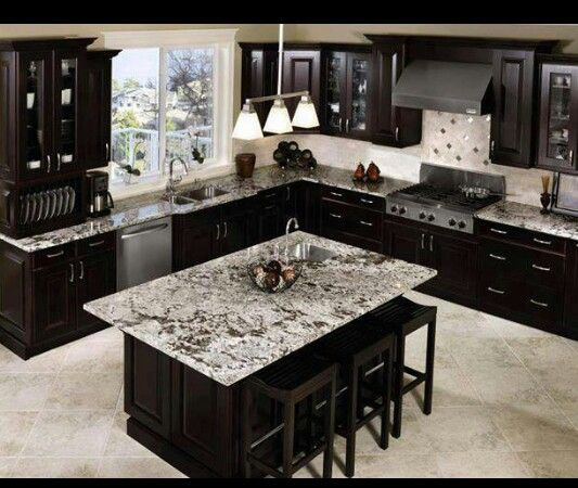 like this look of the dark cabinets and gray countertops