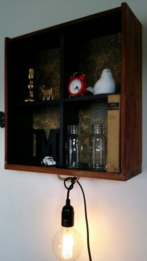 Beautifully functional shelf for Nik Naks, odds and sods as well as a place to hang a cord light.