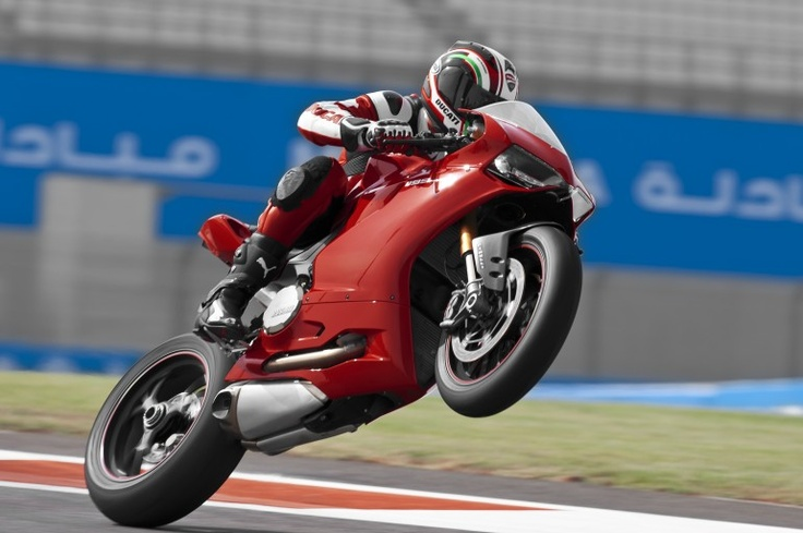 Troy Bayliss on Ducati's newest superbike. A generation of two of big V-twins down the track.