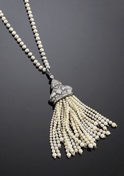 "Victorian tassel necklace - This elegant Victorian-period tassel necklace boasts 191 creamy white natural seed pearls. Twenty-four strands of pearls, ranging in size from 1.8mm to 3.2mm, dangle from a platinum cap encrusted with approximately 2.00 carats of white diamonds. The necklace is crafted of platinum and boasts pearls measuring 2.4mm to 3.3mm.  27"" length"