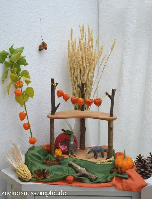 Utterly gorgeous autumn nature table! Stringing the lanterns is such a great idea! Steiner/Waldorf homeschooling idea.