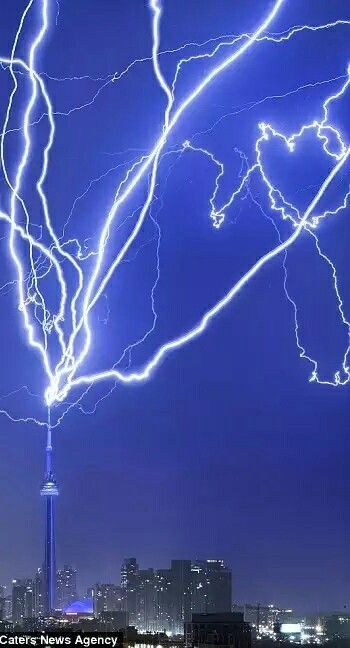 Bright lightning bolts hit the CN Tower in Toronto