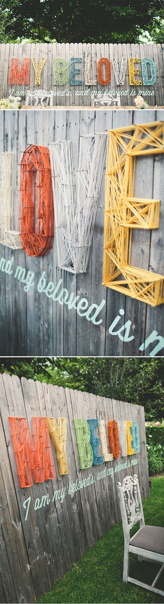 Yarn lettering on a wood fence -- I never would have thought to do this outside!