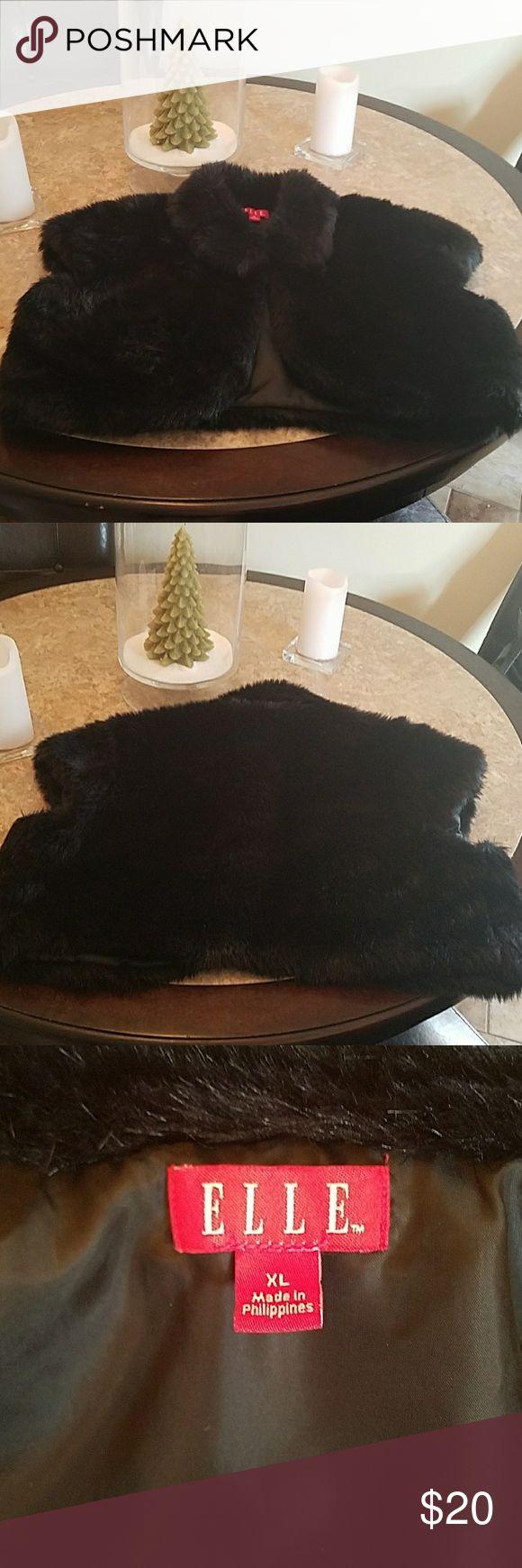 ONE DAY SALE 🖤 Faux Fur Shrug/Vest Soft black faux fur shrug/Vest in excellent condition. Size XL in Juniors. Elle Jackets & Coats Vests