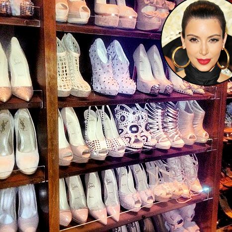 http://www.usmagazine.com/celebrity-style/news/wow-see-kim-kardashians-color-coordinated-shoe-closet-201263    Kim Kardashian's Guilty Pleasure Shoe Closet