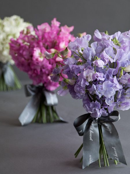 Beautiful bridal bouquet of sweet pea wedding flowers for the bride on her wedding day
