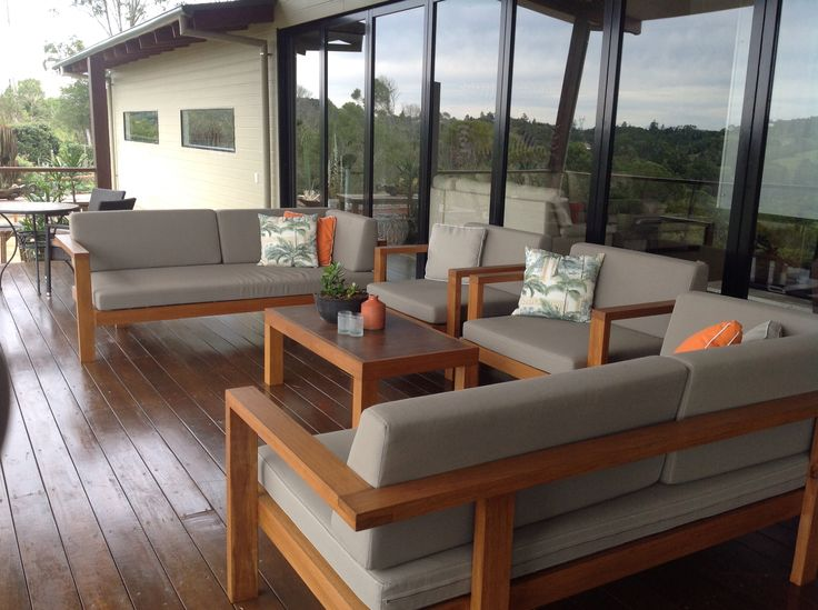 Outdoor seating that can sit 12 people!! used hardwood timber, 2 tiles for coffee table insert and had cushions custom made.
